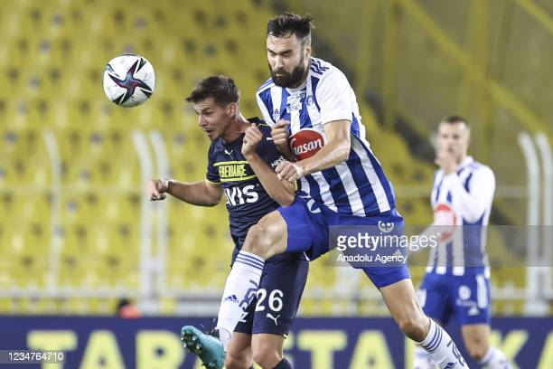 Miha Zajc of Fenerbahce in action against Tim Sparv of HJK Helsinki during UEFA Europa League play-off soccer match between Fenerbahce and HJK...