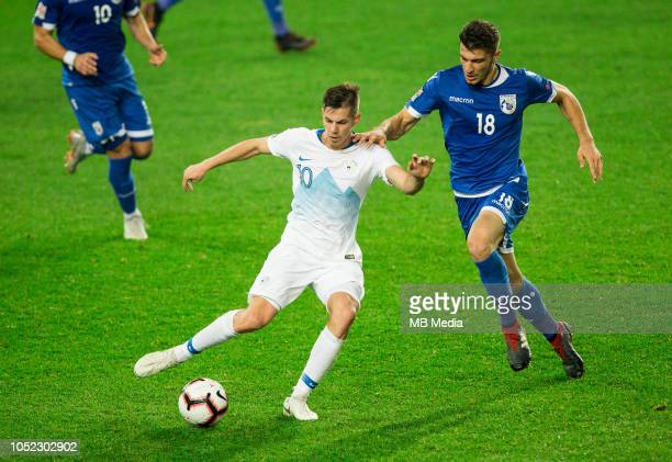 Miha Zajc of Slovenia vs Kostakis Artymatas of Cyprus during the UEFA Nations League C group three match between Slovenia and Cyprus at SRC Stozice...