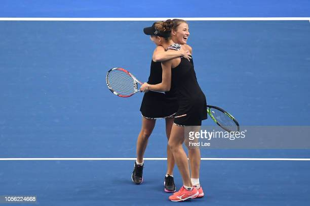 Mihaela Buzarnescu of Romania and Alicja Rosolska of Poland celebrate after defeating against Qianhui Tang of China and Fang Ying Xun of China during...