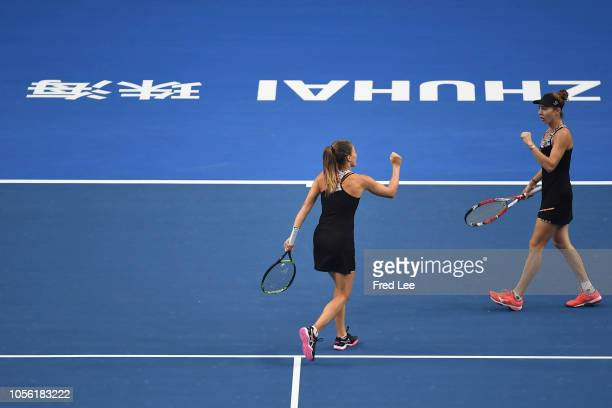 Mihaela Buzarnescu of Romania and Alicja Rosolska of Poland compete against Qianhui Tang of China and Fang Ying Xun of China during their women's...