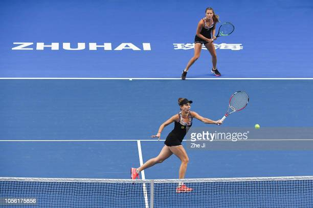Mihaela Buzarnescu of Romania and Alicja Rosolska of Poland return a shot against Qianhui Tang of China and Fang Ying Xun of China during their...