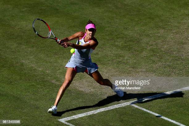 Mihaela Buzarnescu of Romania plays a backhand during her quarterfinal match against Elina Svitolina of Ukraine during Day Seven of the Nature Valley...