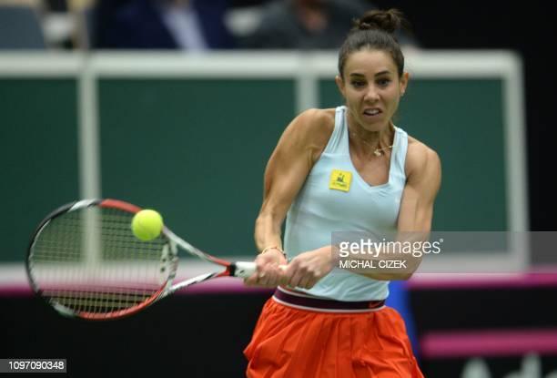 Mihaela Buzarnescu of Romania returns a ball to Katerina Siniakova of Czech Republic during their first round Fed Cup tennis match between Czech...