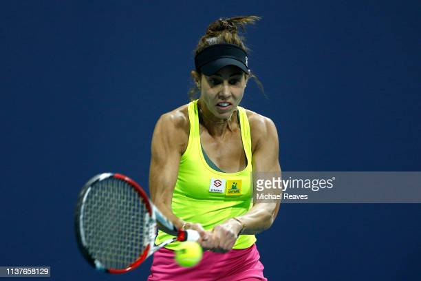 Mihaela Buzarnescu of Romania returns a shot to Alize Cornet of France during Day 5 of the Miami Open Presented by Itau at Hard Rock Stadium on March...