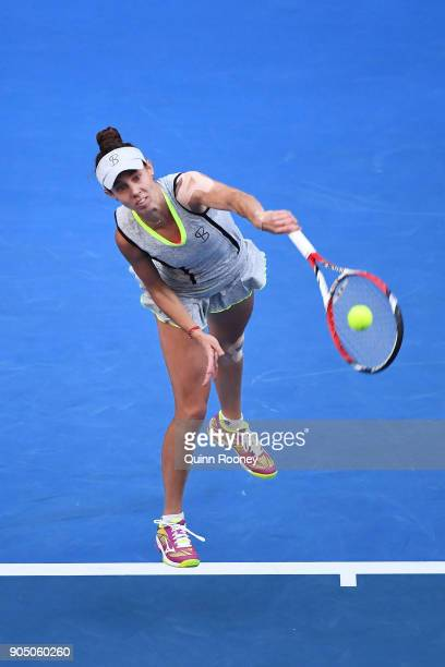 Mihaela Buzarnescu of Romania serves in her first round match against Caroline Wozniacki of Denmark on day one of the 2018 Australian Open at...
