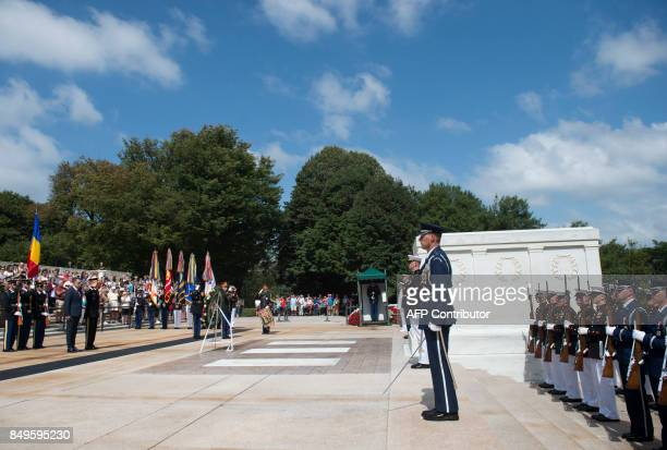Mihai Fifor Romanian Minister of National Defense participates in a wreath laying ceremony at the Tomb of the Unknown Soldier in Arlington National...