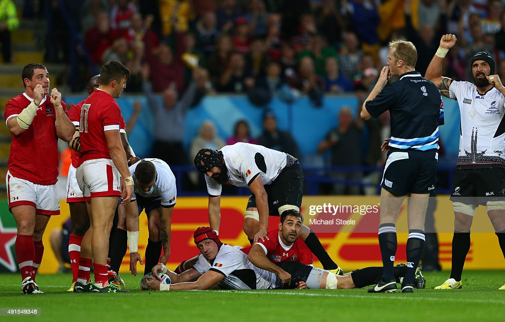 Mihai Macovei of Romania looks at referee Wayne Barnes as he scores their second try during the 2015 Rugby World Cup Pool D match between Canada and Romania at Leicester City Stadium on October 6, 2015 in Leicester, United Kingdom.