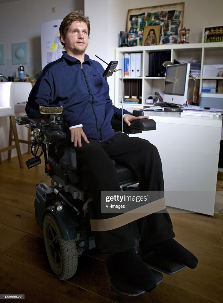 Mihai Nesu who suffered a bad injury during a training session poses for a photo shoot at his home on January 31, 2012 in Utrecht, Netherlands.