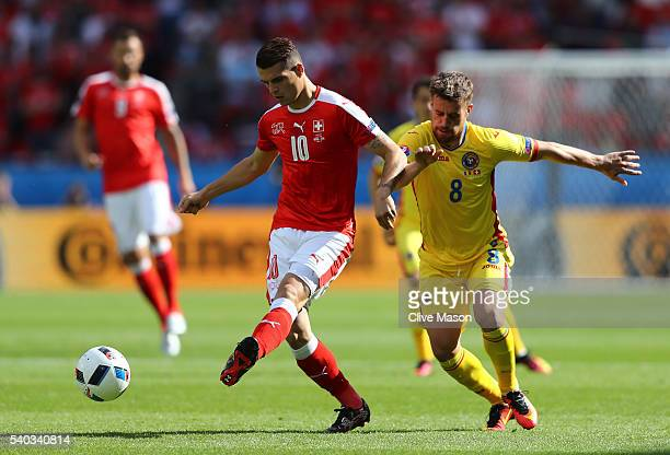 Mihai Pintilii of Romania chases down Granit Xhaka of Switzerland during the UEFA EURO 2016 Group A match between Romania and Switzerland at Parc des...