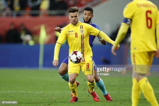Mihai Pintilii of Romania Tonny Vilhena of Holland Vlad Chiriches of Romania during the friendly match between Romania and The Netherlands on...