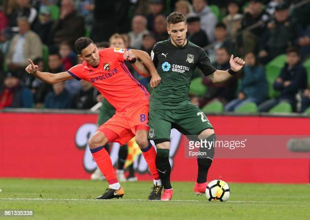Mihailo Ristic of FC Krasnodar is challenged by Georgi Milanov of FC CSKA Moscow during the Russian Premier League match between FC Krasnodar v FC...