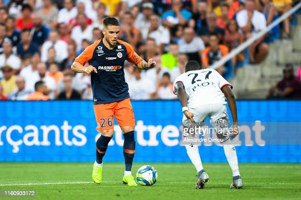 Mihailo Ristic of Montpellier and Hamari Traore of Rennes during the Ligue 1 match between Montpellier and Rennes at Stade de la Mosson on August 10...