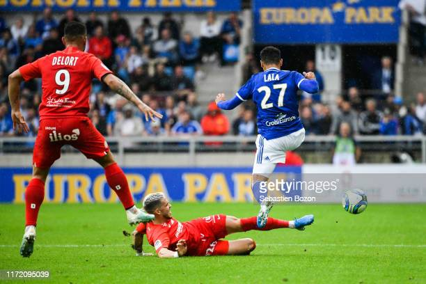 Mihailo RISTIC of Montpellier and Kenny LALA of Strasbourg during the Ligue 1 match between Strasbourg and Montpellier on September 29 2019 in...
