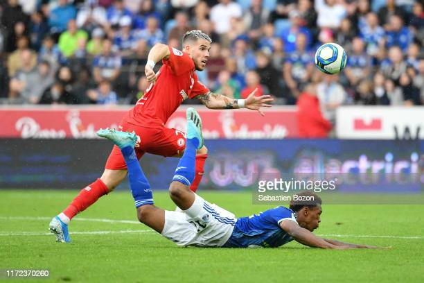 Mihailo RISTIC of Montpellier and Lebo MOTHIBA of Strasbourg during the Ligue 1 match between Strasbourg and Montpellier on September 29 2019 in...
