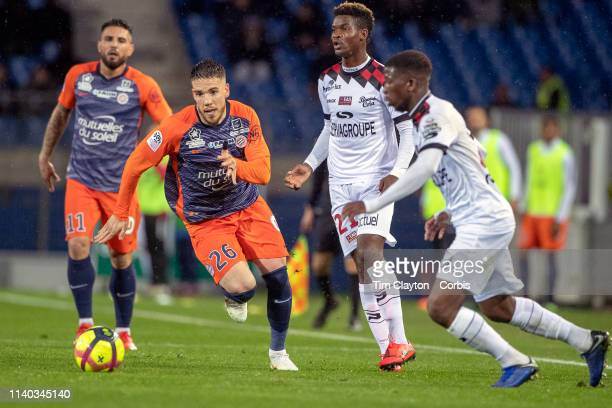Mihailo Ristic of Montpellier defended by Cheick Traore of Guingamp during the Montpellier V Guingamp French Ligue 1 regular season match at Stade de...
