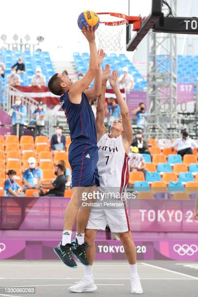 Mihailo Vasic of Team Serbia drives to the basket against Nauris Miezis of Team Latvia in the 3x3 Basketball competition on day three of the Tokyo...