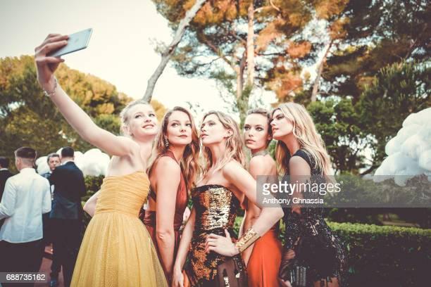Mihalik Hana Jirickova Hannah Ferguson and a guest take a selfie attends the amfAR Gala Cannes 2017 at Hotel du CapEdenRoc on May 25 2017 in Cap...