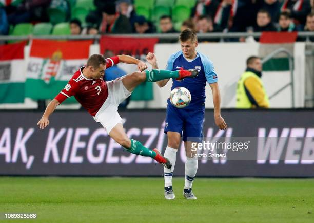 Mihaly Korhut of Hungary fights for the ball with Robin Lod of Finland during the UEFA Nations League group stage match between Hungary and Finland...