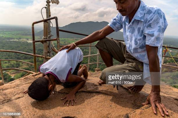 mihintale praying ritual - mihintale stock pictures, royalty-free photos & images