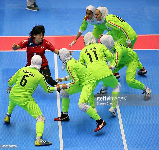 Miho Echizenya of Japan competes against Iran during the Kabaddi Women's Group Round match between Iran and Japan during day nine of the 2014 Asian...