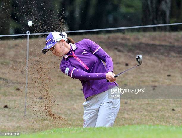 Miho Koga hits out from a bunker on the 7th hole during the first round of the Nishijin Ladies Classic at Kumamoto Kuko Country Club on April 15 2011...