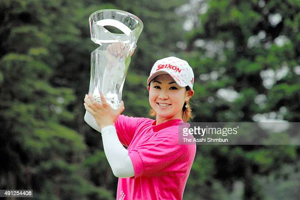 Miho Koga of Japan celebrates with the trophy after winning the Crystal Geyser Ladies Golf Tournament at Keiyo Country Club on May 4 2008 in Chiba...