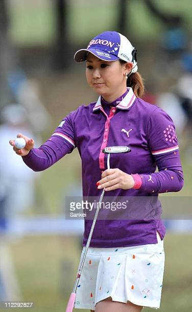 Miho Koga psses the ball to her caddie on the 16th green during the first round of the Nishijin Ladies Classic at Kumamoto Kuko Country Club on April...