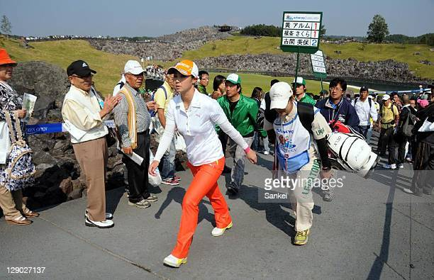 Miho Koga receives cheers from the gallery during the final round of the Sankyo Ladies Open at Yoshii Country Club on October 9 2011 in Takasaki...