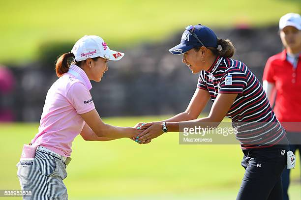 Miho Mori of Japan and Megumi Kido of Japan shake hands after the first round of the Suntory Ladies Open at the Rokko Kokusai Golf Club on June 9...