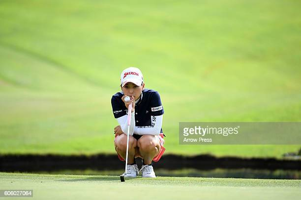 Miho Mori of Japan lines up her putt on the 18th green during the first round of the Munsingwear Ladies Tokai Classic 2016 at the Shin Minami Aichi...