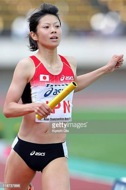 Miho Shingu of Japan crosses the finish line to win the team gold medal in a time of 33500 in the Women's 4x400m Relay final during the day four of...