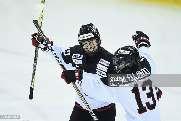 Miho Shishiuchi of Japan celebrates scoring a goal with Moeko Fujimoto during the Women's Ice Hockey International Friendly match between Japan v...