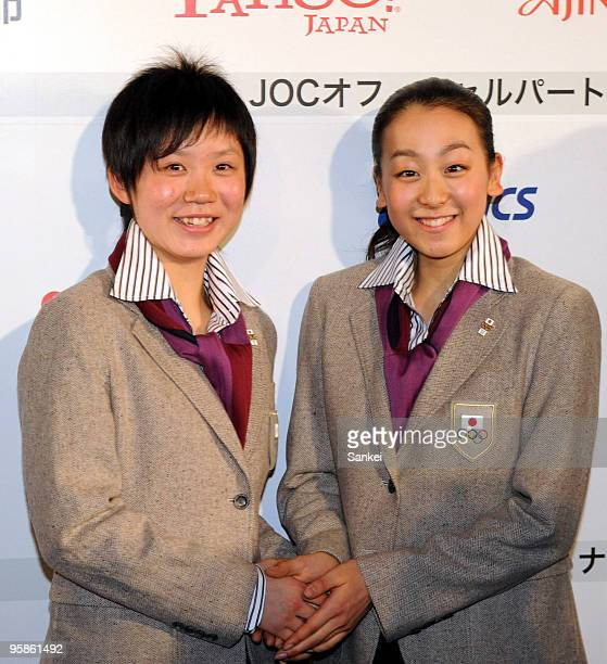 Miho Takagi and Mao Asada shake hands after the Vancouver Olympic SendOff Party at The Prince Park Tower on January 18 2010 in Tokyo Japan