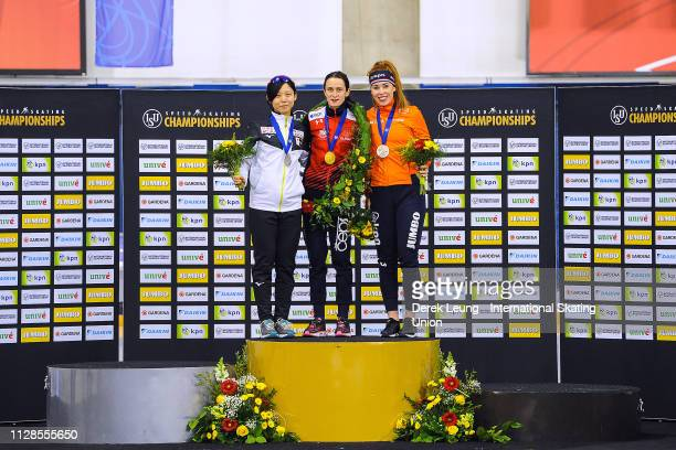 Miho Takagi Martina Sáblíková and Antoinette de Jong stand on the podium after placing in the top 3 overall during the ISU World Allround Speed...