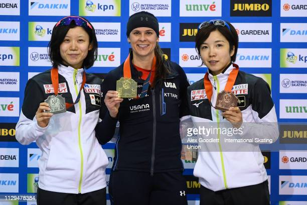 Miho Takagi of Japan Brittany Bowe of the United States and Nao Kodaira of Japan stand on the podium after the women's 1000m duing the ISU World Cup...