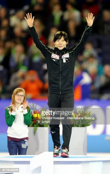 Miho Takagi of Japan poses during the medal ceremony after winning the 1st place of the second ladies 500m Division A race on Day Two during the ISU...