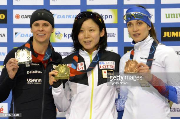Miho Takagi of Japan poses for a photo after winning the women's 1500 meters in a world record time at the World Cup speed skating seasonending event...