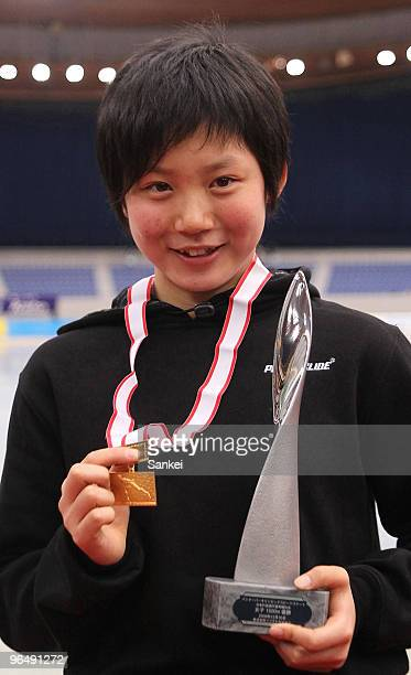 Miho Takagi poses for photographs on the podium after winning the Women's 1500m during the Speed Skating Vancouver Olympic Qualifier at M Wave on...