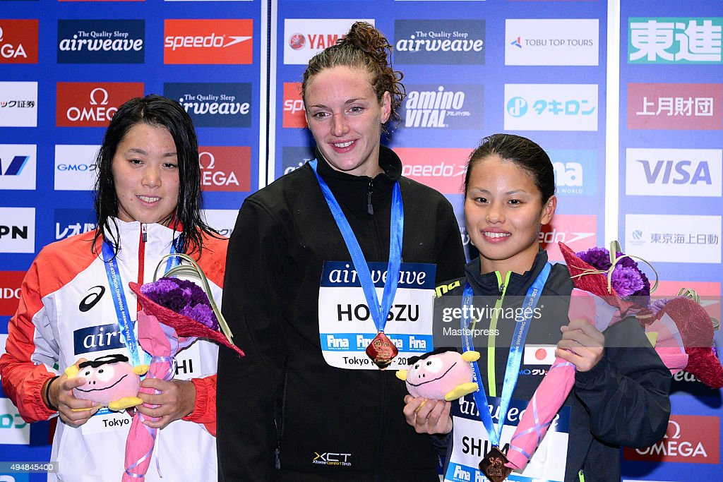 Miho Takahashi of Japan(Silver),Katinka Hosszu of Hungary(Gold) and Sakiko Shimizu of Japan(Bronze) pose on the podium after the Women's 400m Individual Medley final during the FINA Swimming World Cup 2015 at Tokyo Tatsumi International Swimming Pool on October 29, 2015 in Tokyo, Japan.