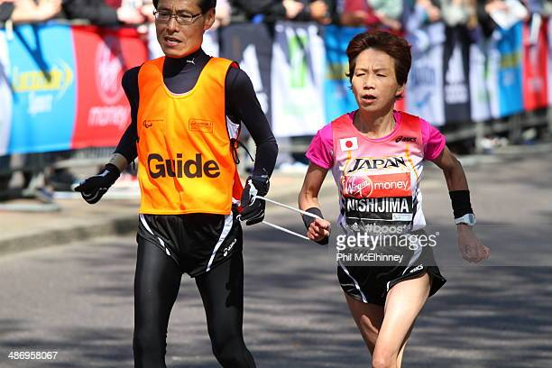 Mihoko Nishijima of Japan takes part in the IPC World Cup for partially sighted runners at the 2014 London Marathon.