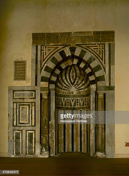 'Mihrab of alHakim Mosque by Fatimid craftsmen 928992 10th Century marble and sandstone Egypt Cairo Whole artwork view The striped arched niche...