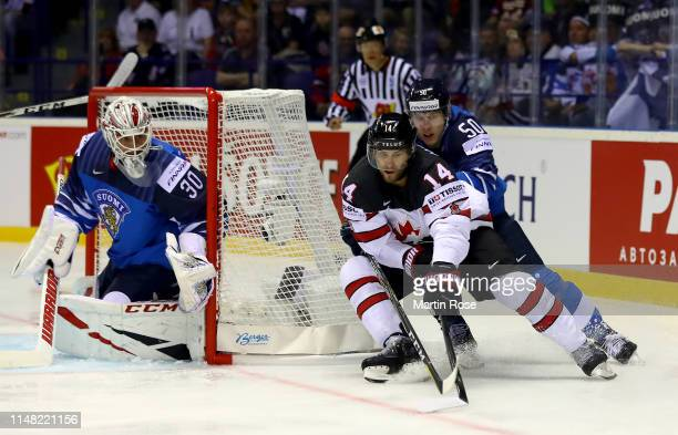 Miika Koivisto of Finland challenges Adam Henrique of Canada during the 2019 IIHF Ice Hockey World Championship Slovakia group A game between Finland...