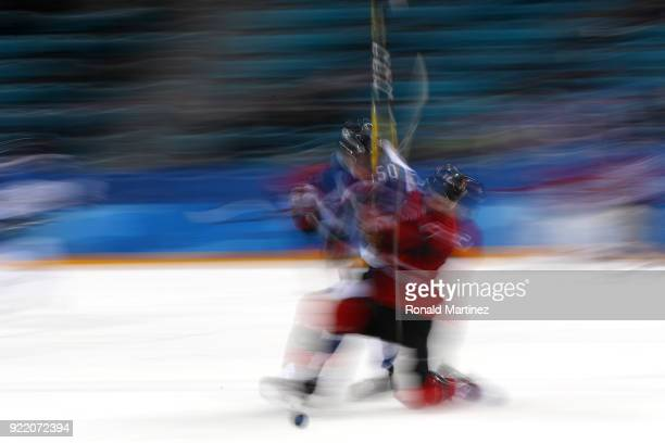 Miika Koivisto of Finland competes for the puck against Mason Raymond of Canada in the second period during the Men's Playoffs Quarterfinals on day...
