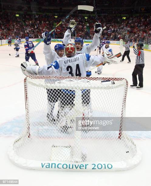 Miikka Kiprusoff of Finland celebrates with his team after defeating Slovakia to win the bronze medal in men's ice hockey on day 16 of the Vancouver...