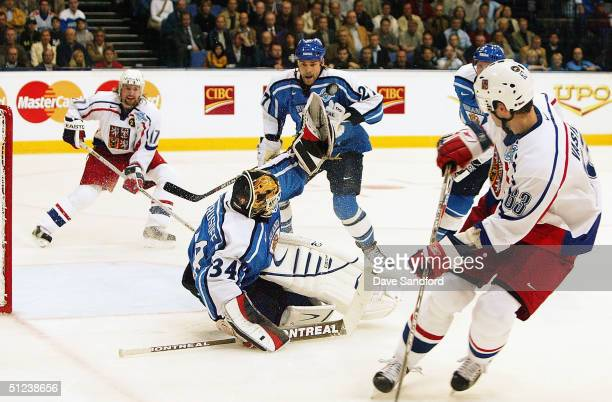 Miikka Kiprusoff of Team Finland makes a huge glove save on Josef Vasicek of the Czech Republic during a game in the World Cup of Hockey tournament...