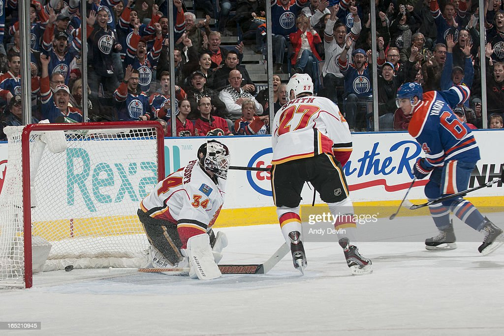 Miikka Kiprusoff #34 of the Calgary Flames allows a third straight goal in the first period in a game against the Edmonton Oilers on April 1, 2013 at Rexall Place in Edmonton, Alberta, Canada.