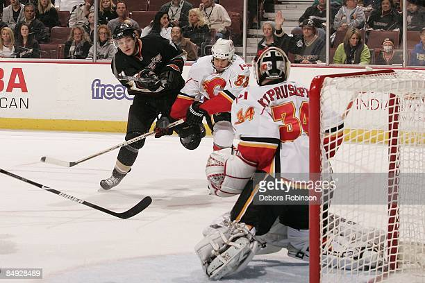 Miikka Kiprusoff of the Calgary Flames defends in the crease against the Anaheim Ducks during the game on February 11 2009 at Honda Center in Anaheim...