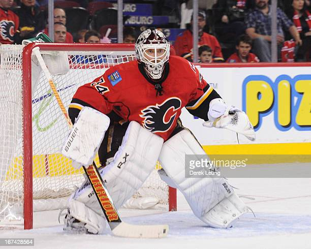 Miikka Kiprusoff of the Calgary Flames defends the net against the Anaheim Ducks during an NHL game at Scotiabank Saddledome on April 19 2013 in...