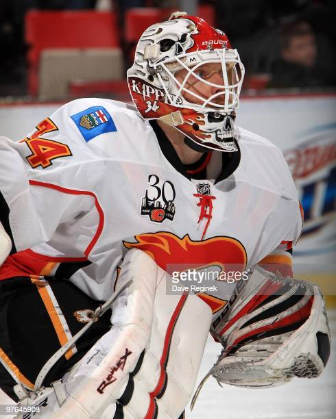 Miikka Kiprusoff of the Calgary Flames focuses on the play during an NHL game against the Detroit Red Wings at Joe Louis Arena on March 9 2010 in...
