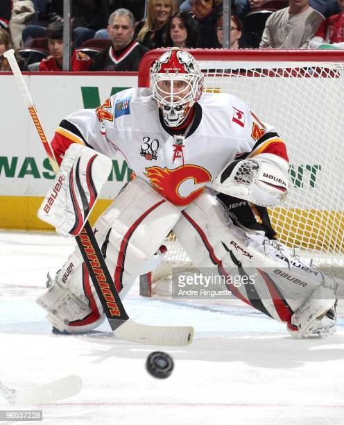 Miikka Kiprusoff of the Calgary Flames focuses on the puck in a game against the Ottawa Senators at Scotiabank Place on February 9 2010 in Ottawa...